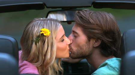 romantic couple : Happy couple kissing in the car in slow motion