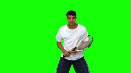 ракетка : Man training while playing tennis on green screen in slow motion