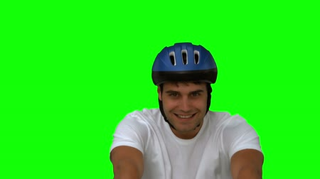 cycle : Man on his bicycle on green screen in slow motion Stock Footage