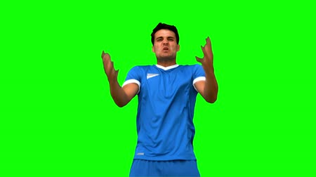 porażka : Angry football player holding his head on green screen in slow motion
