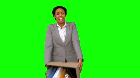 desistir : Fired businesswoman dropping a box on green screen in slow motion