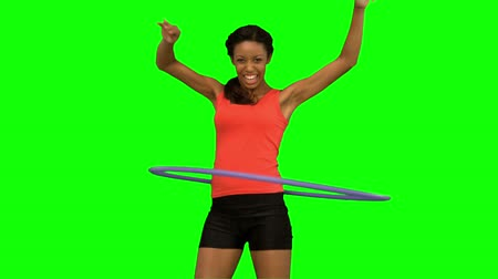 abroncs : Woman playing with a hula hoop on green screen in slow motion