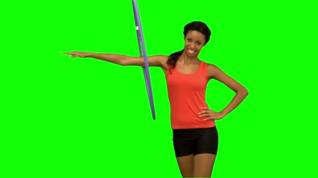 abroncs : Woman working out with a hula hoop on green screen in slow motion Stock mozgókép