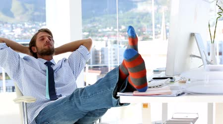 sock : Businessman sleeping at his office with feet on the desk Stock Footage