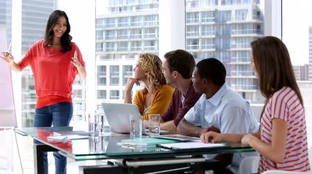 discussion meeting : Woman giving presentation to her colleagues during a meeting