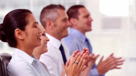 success : Cheerful business people applauding during a meeting  Stock Footage