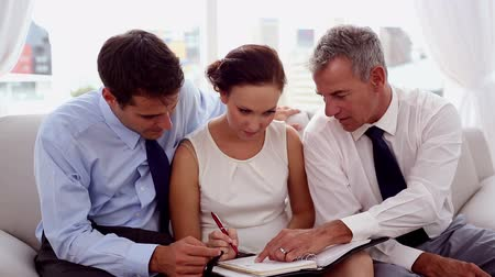 dialog : Businessmen pointing at a colleagues diary to fix an appointment Wideo