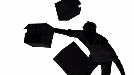 tektura : Silhouette of clumsy man dropping boxes on white background in slow motion