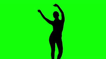 stín : Silhouette of woman moving arms in the air on green screen in slow motion Dostupné videozáznamy