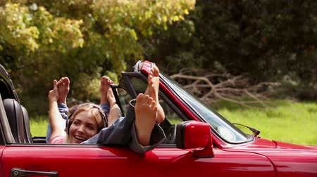 boso : Happy girls listening to music in a red car in the sunshine Wideo