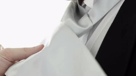 krawat : Handsome groom getting his tie bonded on white background Wideo