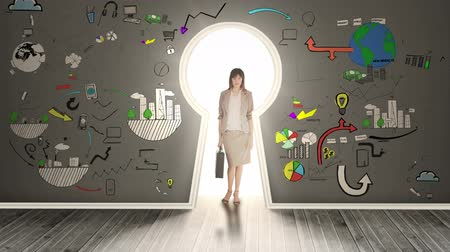 портфель : Businesswoman posing in glowing keyhole surrounded by animations on grey wall Стоковые видеозаписи