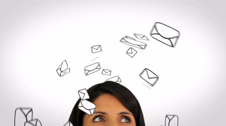 uçan : Animation of envelopes circling a womans head on white background Stok Video