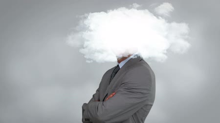 spojení : Businessman posing with arms crossed with cloud in front of his head