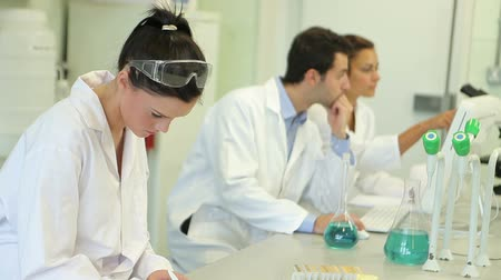 chemistry : Chemistry students working on an experiment in the lab at the university Stock Footage