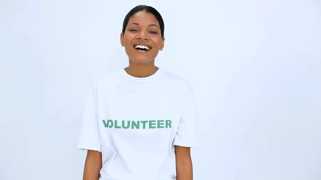 jótékonyság : Volunteer woman does sign at camera on white background Stock mozgókép
