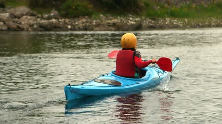 kayak : Woman kayaking in a river away from the camera in slow motion Stock Footage