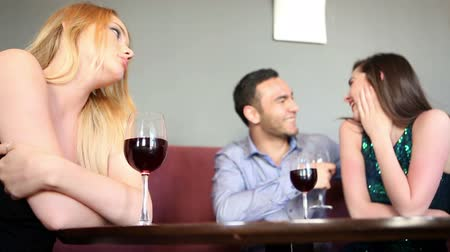 jealous : Single woman being envious at happy couple on background Stock Footage