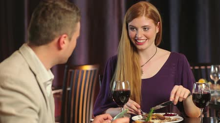 redhead suit : Attractive couple dining together in a classy restaurant