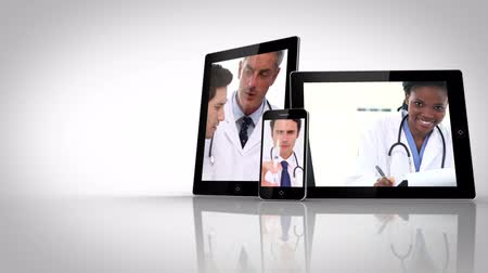 zöld : Different electrical devices showing doctors on white background