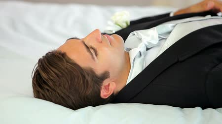 двадцатые годы : Groom lying down before his wedding on a bed at home
