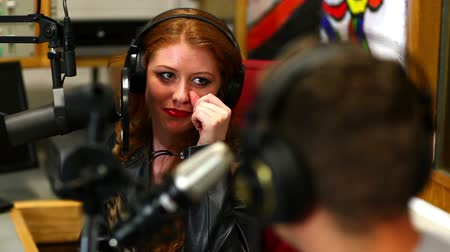 радио : Pretty student interviewing someone for radio in the studio in college