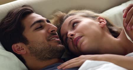záhon : Cute couple talking in bed at home in bedroom Dostupné videozáznamy