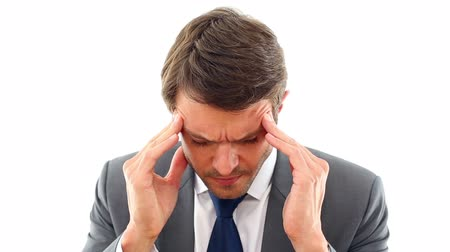 ideges : Businessman getting a headache in the office