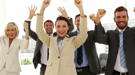 torcendo : Business people cheering at the camera in the office Stock Footage