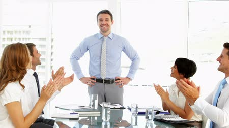 discussion meeting : Businessman receiving praise from his employees at meeting and giving thumbs up in the office Stock Footage