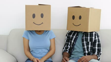 ostoba : Silly employees with boxes on their heads in creative office Stock mozgókép