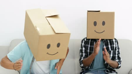 ostoba : Silly employees with boxes on their heads doing the robot in creative office