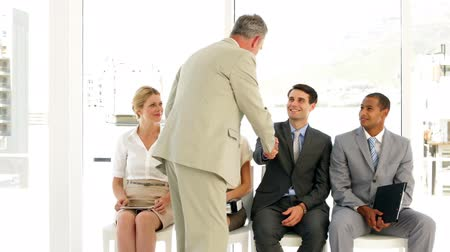 boss : Businessman taking applicant away to be interviewed at the office