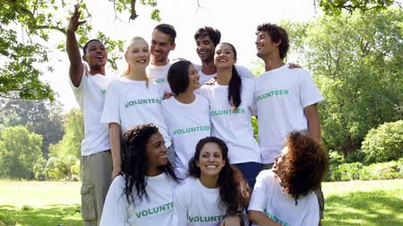 wolontariat : Group of volunteers smiling at the camera on a sunny day