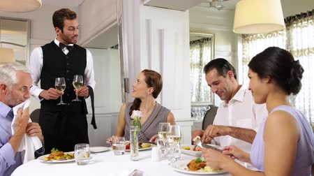 ресторан : Waiter attending to a table of friends at a restaurant
