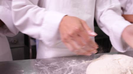hamur : Pastry chefs preparing dough at counter in a commercial kitchen Stok Video
