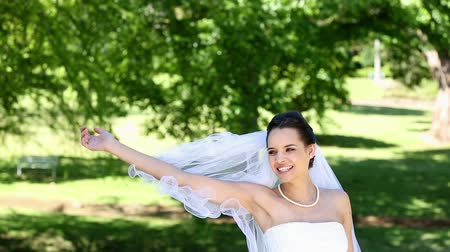 bouquets : Beautiful bride throwing her bouquet on a sunny day