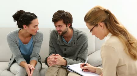 psikoloji : Young unhappy couple talking with their therapist at therapy session