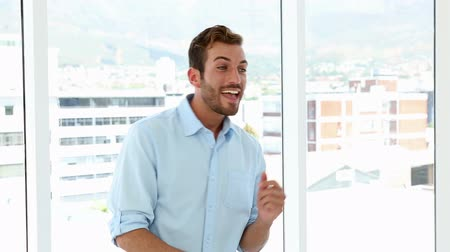profesyonel meslek : Happy businessman dancing in his office