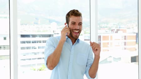 business man : Happy businessman dancing after getting good news in his office Stock Footage