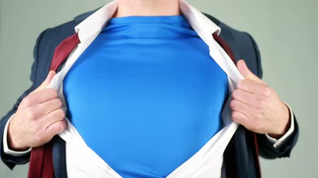 biznesmeni : Businessman opening shirt in superhero style on light background Wideo