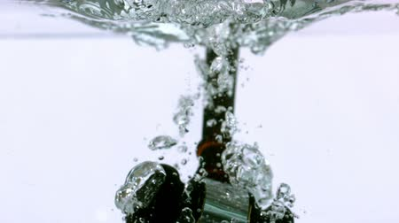árverezői kalapács : Ceremonial mallet falling into water in slow motion Stock mozgókép