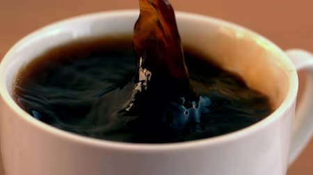 bögre : Sugar cube falling into cup of coffee in slow motion Stock mozgókép