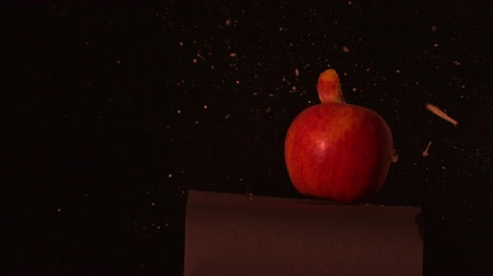 strzałki : Arrow shooting through red apple on black background in slow motion Wideo