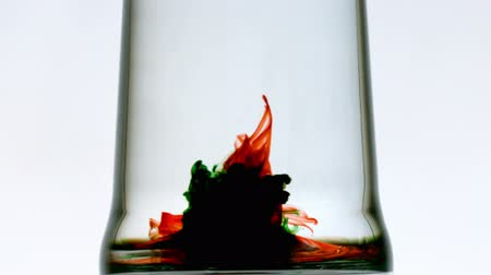 pint glass : Colourful whirlpool in pint of water on white background in slow motion