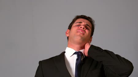 kaslı : Businessman rubbing his sore neck in slow motion