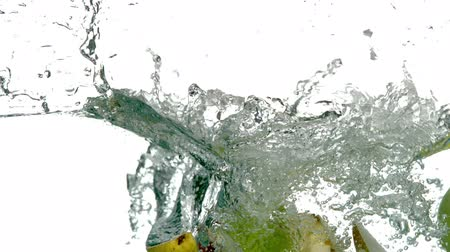 fresco : Pear and apple segments plunging into water on white background in slow motion