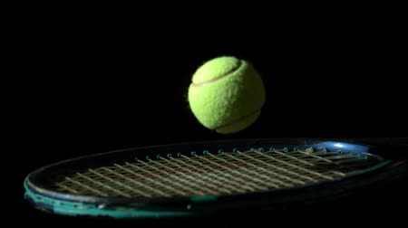 tennis game : Tennis ball bouncing on a racket in slow motion