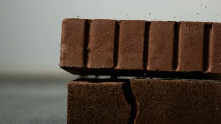 cegła : Brick falling on and breaking another in slow motion Wideo