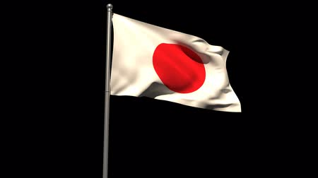 mastro de bandeira : Japan national flag waving on flagpole on black background Vídeos
